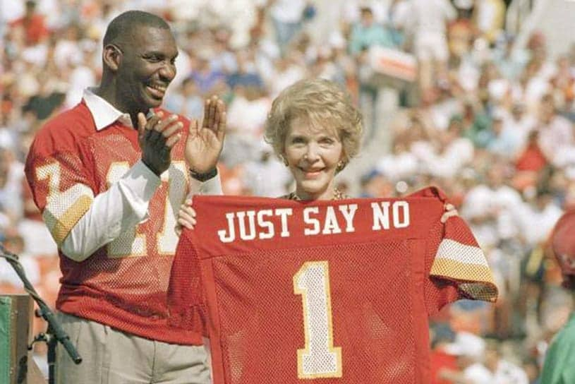 Picture of nancy raegan holding a jersey that says just say no on the back